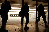 Airmen test their skills at the shooting range