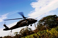 U.S. Army UH_60 Black Hawk helicopter flies out of an emergency landing zone
