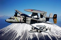 Two E_2C Hawkeyes conduct a mountain flyby