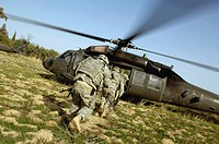 U.S. Army Soldiers prepare to board a UH_60 Black Hawk helicopter