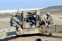 Marines prepare to fire a howitzer