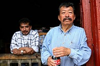 Mexico. Michoacan. Pazcuaro. Two mexican men at the door shop