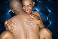 Sexy nude African_American couple embracing