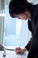 The Businessman Who Writes A Name At A Reception Desk (thumbnail)
