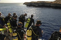 Divers entering water from back of dive boat VIP ONE, Red Sea, Egypt