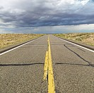 Empty two lane highway leading to desert horizon