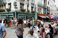 People sitting at an outdoors cafe in a pedestrian street, Nantes, Brittany, France