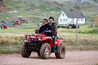 Women riding an ATV at Qassiarsuk, South Greenland