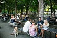 People sitting at a beer garden in Letna Park, Prague, Czech Republic