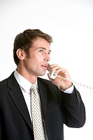 Businessman using telephone, side view