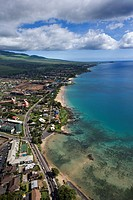 Aerial of Maui, Hawaii coastline with beach, road and buildings