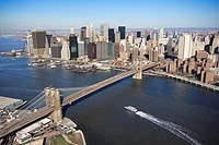 Aerial view of in New York City with Brooklyn Bridge and Manhattan skyline with ferry boat