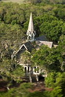 Aerial view of church surrounded by trees on Bald Head Island, North Carolina.