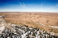 Aerial landscape of snowy plains and dunes in Great Sand Dunes National Park, Colorado