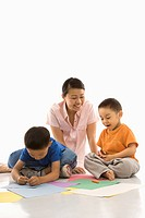 Mother with boys coloring