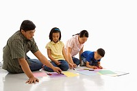 Parents sitting on floor with children