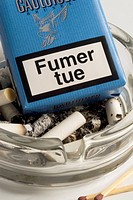 Fumer tue. French cigarette pack. Smoking kills. Ashtray. Matches
