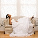 Bride lying on love seat