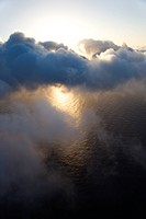 View from above the clouds with Pacific ocean underneath