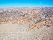 Aerial veiw of remote California desert with mountain range in background