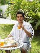 man having breakfast outside