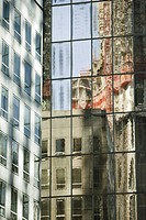 Reflection of building on widows of steel and glass high rise office building, cropped (thumbnail)