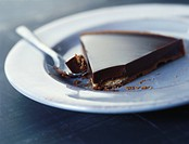 Slice of chocolate tart with spoon (thumbnail)