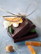 Chocolate bars tied together with string, candied fruit, hazelnut (thumbnail)