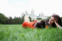 Couple lying on grass low angle view