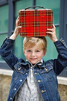 Boy holding briefcase