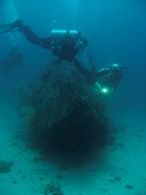 2 divers on wreck. Sabang. Philippines. Taken 2007