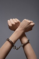 Woman's hands in handcuffs close_up
