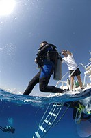 Technical Divers using Trimix, entering water from dive boat, Divetech, Grand Cayman, Cayman Islands, Caribbean