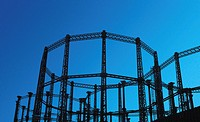 Silhouette view of Victorian gasholders, London, UK