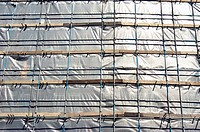 Building covered by a scaffolding net
