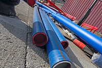 Utility pipes laying on the pavement (thumbnail)