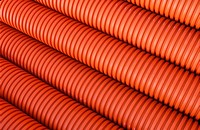Stockpile of ribbed flexible plastic pipes
