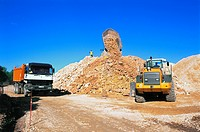 Excavator and dumptruck on a road building site