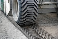 View of large truck wheel, road building operations (thumbnail)