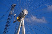 Crane inspection of hub on London Eye, Millennium Wheel just after erection