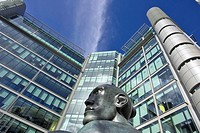 Office building with modern statue, Paddington basin regeneration area, London. UK