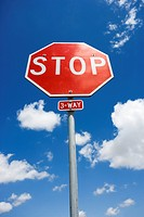 Stop sign with blue cloudy sky
