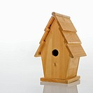 Wooden birdhouse against white background
