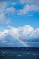 Seascape of the Pacific Ocean near Maui, Hawaii with rainbow and clouds