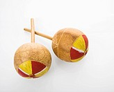 Pair of handmade Mexican maracas percussion musical instruments against white background