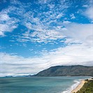 Scenic coastal view from Queensland Rex Lookout with mountains in background under blue sky with clouds