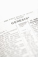 Selective focus of Genesis verses in open Holy Bible (thumbnail)