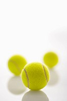 Three tennis balls