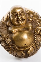 Happy laughing Buddha brass figurine on white background