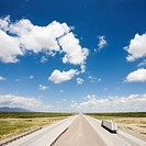 High angle view of highway with tractor trailer truck and blue cloudy sky (thumbnail)